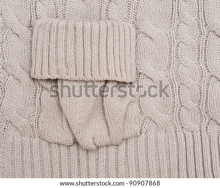 Knitted woolen background with a pocket. Look through my portfolio to find more images of the same series