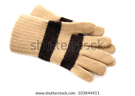 Knitted woolen brown gloves on a white background