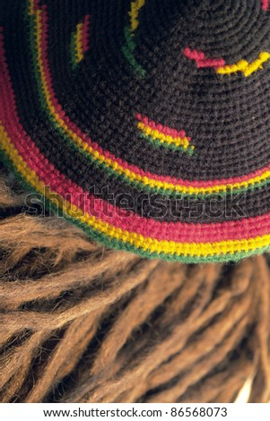 knitted woolen rasta cap and dreadlocks