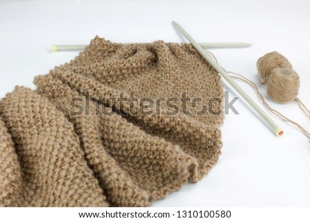 knitted work of soft scarf in mohair yarn, white background