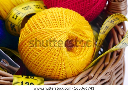 Knitting and tape on the background of baskets #165066941