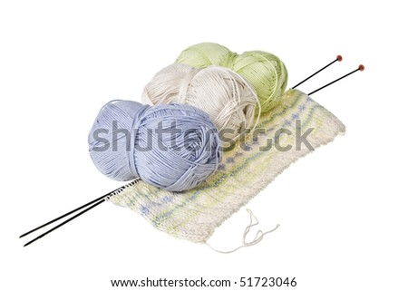 Knitting balls and knitting needles isolated on white.