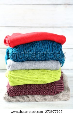 Knitting clothes on wooden background #273977927