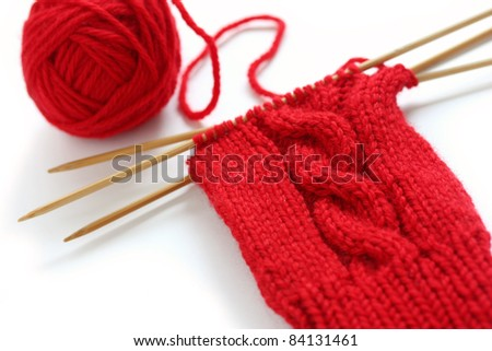 knitting image, a red yarn ball with noodles