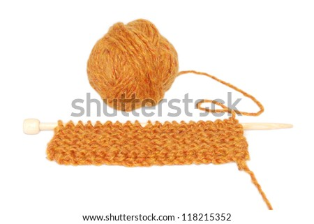 Knitting in garter stitch on one needle with a ball of wool, isolated on a white background