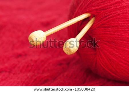 Knitting needle a red woolen yarn