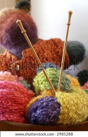 stock photo : knitting needles in balls of yarn