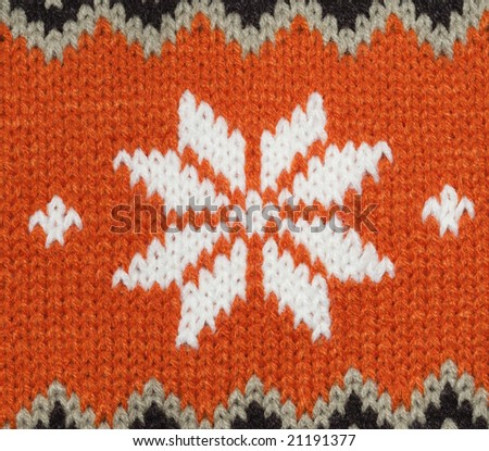 Knitting texture with ornament, orange and white