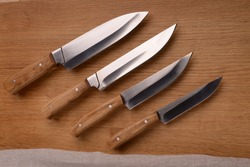 knives with a wooden handle,made of steel, steel, black steel, blades, on the procurement, a set of Japanese, Japanese knives, high-quality steel, kitchen knife. sparkle