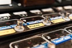 knobs on a guitar pedal board