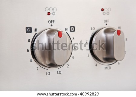 Knobs on a modern stainless steel stove