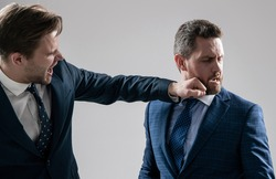 knockout. struggle for leadership. displeased colleague dispute. negotiations. businessmen fighting and punching. boss and employee have conflict. disagreed men partners. business competition.