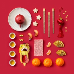 Knolling concepts Chinese New Year objects on red background.