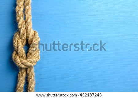 knot on blue wooden background