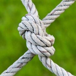 Knot rope netting with a green background.