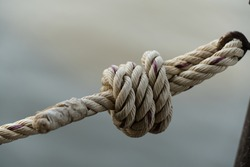 Knot rope or strand with light gray background, indirect symbol for implying to problem, simplicity, strong, strengthen, durable, unity