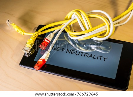 knotted net cable over a smartphone with the words Net Neutrality on screen. Suitable for concepts as net neutrality regulations, Internet Freedom Preservation Act , Open Internet order. - Shutterstock ID 766729645