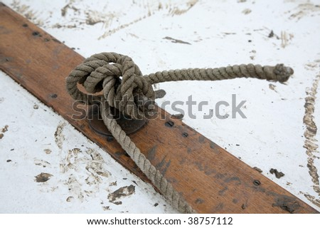 Knotted rope on a muddy background