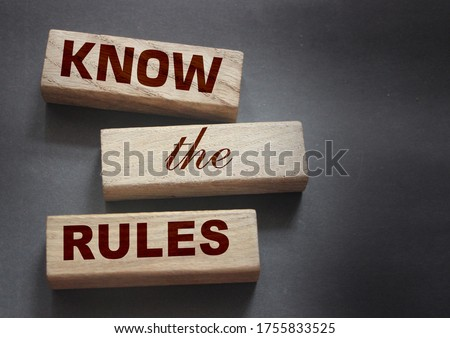 Know the rules word on wooden blocks isolated on dark grey background. business process regulation concept. Photo stock ©