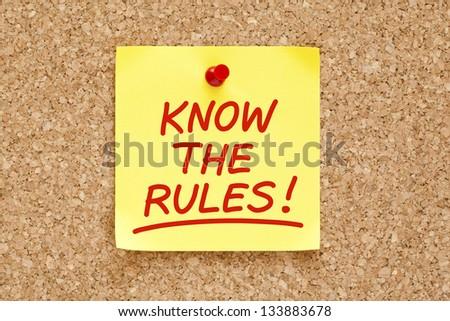 Know The Rules written on yellow sticky note with red marker.