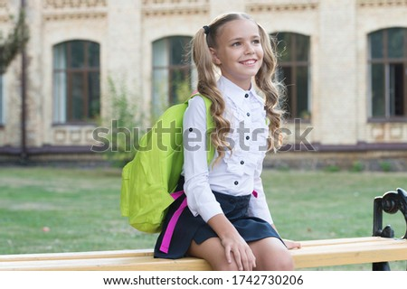 Knowledge is light. Happy child on September 1. Knowledge day. Little girl carry school backpack. Education and study. Knowledge and skills. Private teaching. Startup. Back for knowledge.