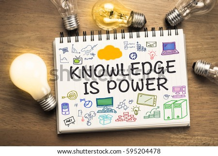 Knowledge is Power text on sketching notebook with many light bulbs