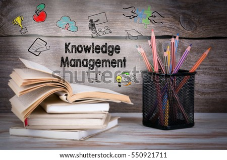 knowledge management. stack of...