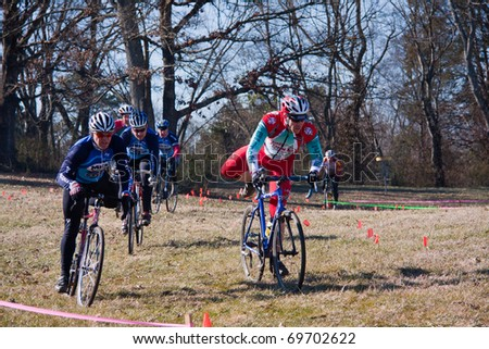 KNOXVILLE - JANUARY 22: Racers from various cycling teams compete during the annual Knoxiecross cyclocross series, January 22, 2011, Victor Ashe Park, Knoxville, Tennessee.
