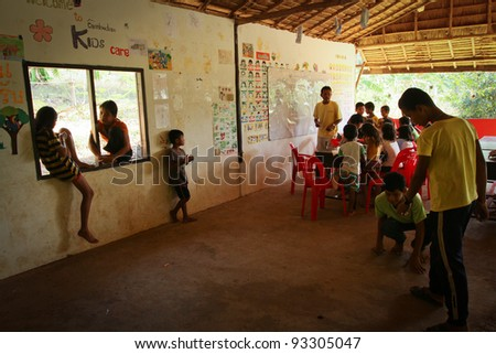 KO CHANG, THAILAND - JANUARY 6: Unknown children in lesson at school by project Cambodian Kids Care to help deprived children in deprived areas with education, on January 6, 2012 on Ko Chang, Thailand - stock photo