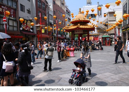 KOBE, JAPAN - APRIL 24: Visitors enjoy sunny weather in Chinatown station on April 24, 2012 in Kobe, Japan. Nankinmachi, Kobe's Chinatown is the 2nd largest in Japan and a popular tourism attraction.