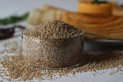 Kodo millet, also known as cow grass, rice grass, Native Paspalum, or Indian Crown Grass is an annual grain used for cooking in many parts of the world. Shot with pancakes in the background.