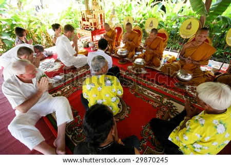 KOH LANTA - DECEMBER 2: Western couple gets married during a traditional Buddhist wedding on December 2, 2008 in Koh Lanta, Thailand.