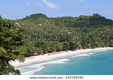 KOH PHANGAN, THAILAND - NOVEMBER 21, 2015 : Beautiful Thong Nai Pan Noi Beach with palm trees and bungalows for tourists. On the island Koh Phangan each month passes full moon party for tourists