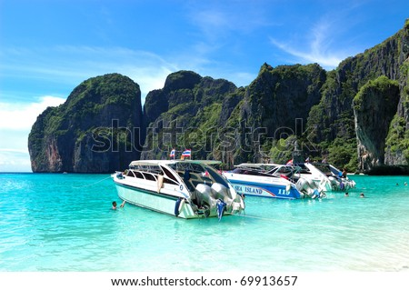 KOH PHI PHI, THAILAND - SEPTEMBER 13: Motor boats on turquoise water of Maya Bay lagoon on September 13, 2010 in Koh Phi Phi island, Thailand. 15841683 tourists have visited Thailand in year 2010