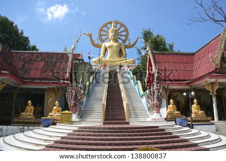 KOH SAMUI THAILAND DEC 4 Tourists at Wat Phra Yai on December 4 2008 in Koh Samui The 12-metre high seated Buddha statue built in 1972 is one of the islands most popular attractions