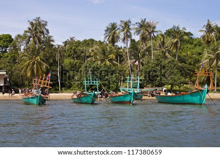 KOH TONSAY, CAMBODIA - JULY 23: Tourists on a boat on July 23, 2012 at Koh Tonsay island, Cambodia. Koh Tonsay is also called Rabbit Island.