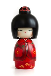 Kokeshi doll in red kimono. Still-life photo (taken on studio with white background and softbox) of a Japanese traditional doll isolated on white.