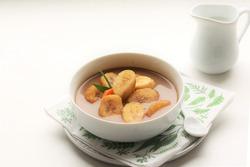 Kolak pisang is Indonesian traditional dessert made of banan and sweet potato with palm sugar sauce. Selective focus