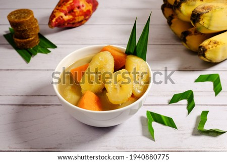 Kolak pisang ubi or banana and sweet potato compote is popular dessert in Indonesia especially during Ramadhan. The banana  sweet potato is cooked with coconut milk, palm sugar and pandanus leaves. ストックフォト ©
