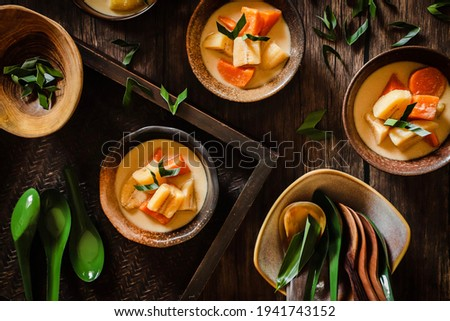 Kolak Pisang Ubi. Sweet dessert of banana and sweet potato in sweet coconut milk soup.