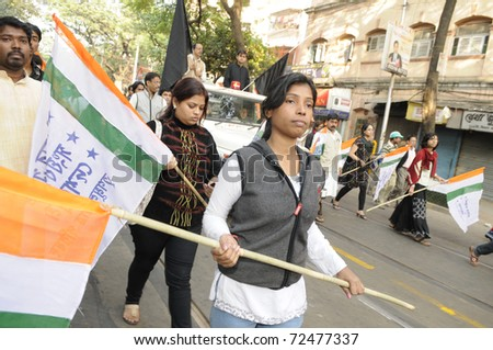 KOLKATA- DECEMBER 20: Young teens participating in a silent rally with one of their supporter's corpse in Kolkata, India on December 20, 2010.