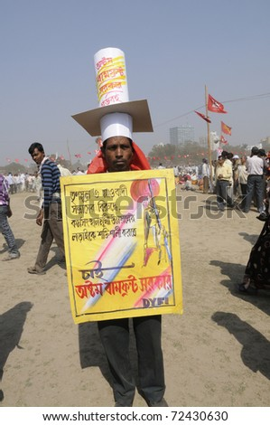 KOLKATA- FEBRUARY 13: A man shows support towards the formation of 8th successive Left Front Government in West Benagal in his own way,during a political rally  in Kolkata, India on February 13,2011.