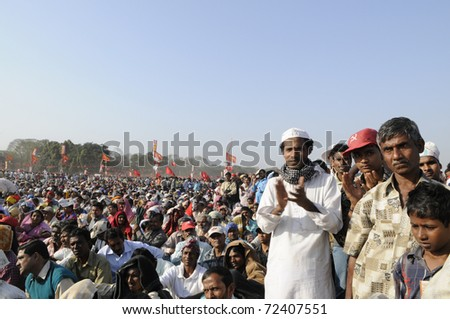 KOLKATA- FEBRUARY 13: A Muslim follower clapping during a political rally  in Kolkata, India on February 13, 2011.