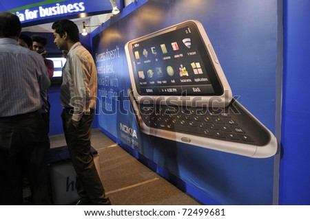 KOLKATA- FEBRUARY 20: A NOKIA E7 model projected to the customers  during the Information and Communication Technology (ICT) conference and exhibition in Kolkata, India on February 20, 2011.