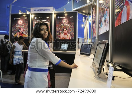 KOLKATA-FEBRUARY 20:A sales associate looking at the camera ,during the Information and Communication Technology conference and exhibition in Kolkata,India on February 20,2011.