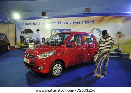KOLKATA- FEBRUARY 20:  A visitor looks into the specifications of a Hyundai car, during the Information and Communication Technology  conference and exhibition in Kolkata, India on February 20,2011.
