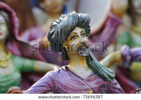 KOLKATA - FEBRUARY 23: An abstract art of a tribal man  made out of clay ,on display during the Handicraft Fair in Kolkata-the biggest of its kind in Asia on February 23,2011 in Kolkata,India.