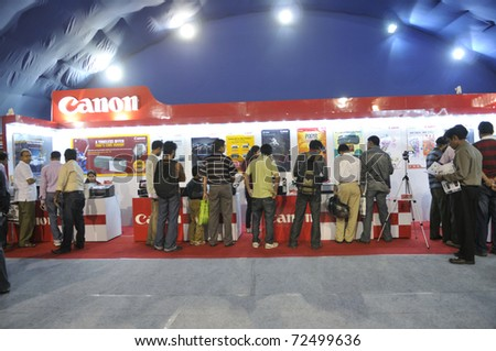 KOLKATA- FEBRUARY 20:  Consumers flocking inside a CANON booth, during the Information and Communication Technology (ICT) conference and exhibition in Kolkata, India on February 20, 2011.