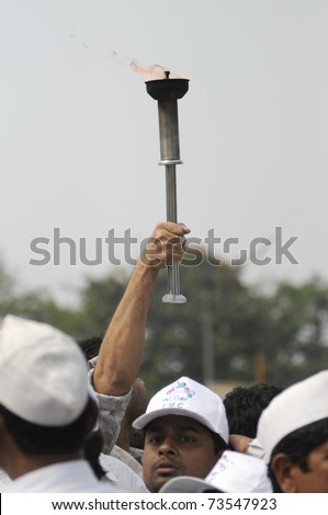 KOLKATA - FEBRUARY 20: Supporters of All India Trinamool Congress holding a flamed torch  during a rally organized to kick the 2011 election champagne, in Kolkata, India on February 20, 2011.