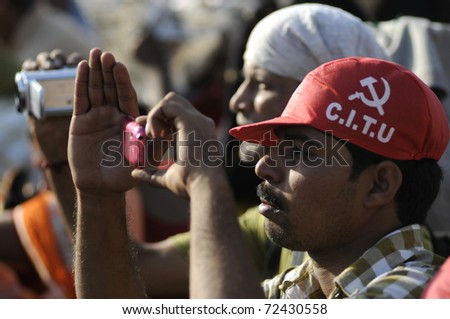 KOLKATA- FEBRUARY 13:  Two supporters filming the entire event, one on a mobile camera another one with a handicam- during a political rally  in Kolkata, India on February 13, 2011.